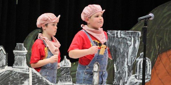 boys dressed as railroad engineers